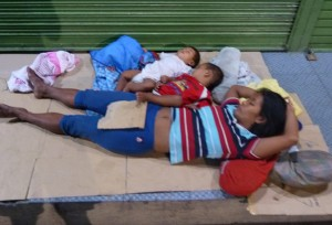 family-sleeping-on-street